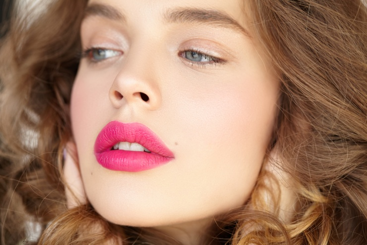 Close-up portrait of beautiful girl with pink lips